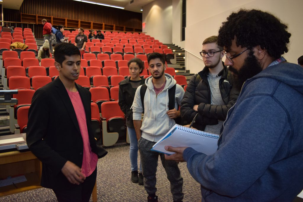 Kavun answering student questions after class.